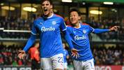 VERL, GERMANY - OCTOBER 30:  Janni Serra (L) and Jae-sung Lee of Kiel celebrate their teams first goal during the DFB Cup second round match between SC Verl and Holstein Kiel at Sportclub Arena on October 30, 2019 in Verl, Germany. (Photo by Thomas F. Starke/Bongarts/Getty Images)