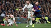 Barcelona's Argentinian forward Lionel Messi (R) vies with Real Madrid's Spanish defender Sergio Ramos during the Spanish league football match between Real Madrid CF and FC Barcelona at the Santiago Bernabeu stadium in Madrid on March 2, 2019. (Photo by CURTO DE LA TORRE / AFP)        (Photo credit should read CURTO DE LA TORRE/AFP via Getty Images)