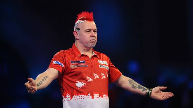 LONDON, ENGLAND - DECEMBER 23: Peter Wright of Scotland celebrates after winning his Third Round match against Seigo Asada of Japan during Day Eleven of the 2020 William Hill World Darts Championship at Alexandra Palace on December 23, 2019 in London, England. (Photo by Alex Burstow/Getty Images)