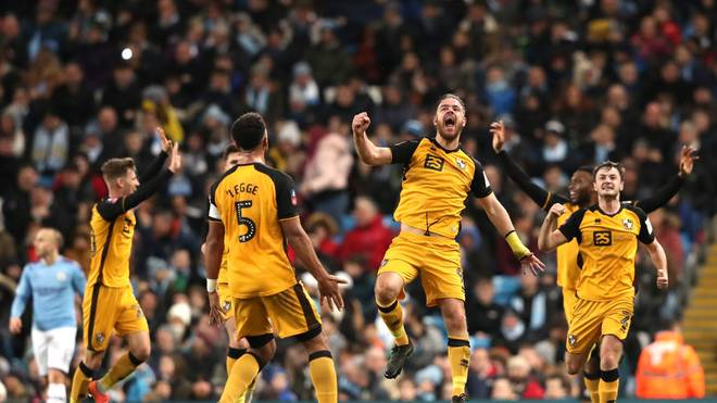 MANCHESTER, ENGLAND - JANUARY 04: Tom Pope of Port Vale celebrates after scoring his team's first goal during the FA Cup Third Round match between Manchester City and Port Vale at Etihad Stadium on January 04, 2020 in Manchester, England. (Photo by Alex Livesey/Getty Images)