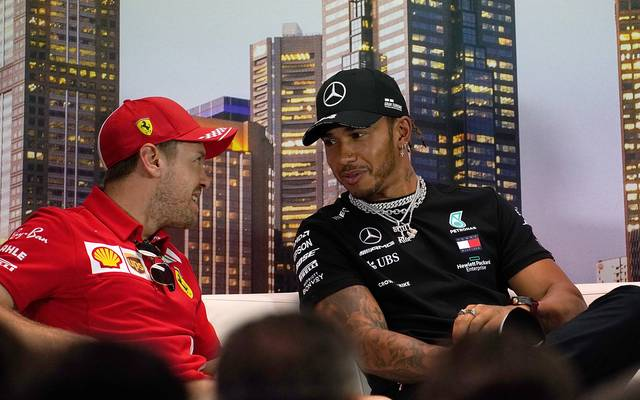 Sebastian Vettel (l.) und Lewis Hamilton haben zusammen zehn WM-Titel