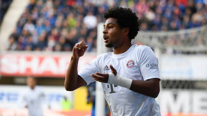 Munich's German forward Serge Gnabry celebrates scoring the 0-1 goal during the German first division Bundesliga football match SC Paderborn 07 v Bayern Munich in Paderborn, western Germany on September 28, 2019. (Photo by INA FASSBENDER / AFP) / DFL REGULATIONS PROHIBIT ANY USE OF PHOTOGRAPHS AS IMAGE SEQUENCES AND/OR QUASI-VIDEO        (Photo credit should read INA FASSBENDER/AFP/Getty Images)
