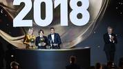 TOPSHOT - 2018 Ballon d'Or awarded for best player of the year, Men's Ballon d'Or Real Madrid's Croatian midfielder Luka Modric (C), Women's Ballon d'Or Olympique Lyonnais' Norwegian forward Ada Hegerberg (L) and Under-21 Ballon d'Or (Kopa trophy) Paris Saint-Germain's French forward Kylian Mbappe (2ndR) pose past former French footballer and host David Ginola at the end of the 2018 Ballon d'Or award ceremony at the Grand Palais in Paris on December 3, 2018. (Photo by FRANCK FIFE / AFP)        (Photo credit should read FRANCK FIFE/AFP via Getty Images)