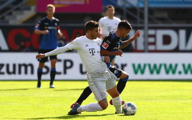 PADERBORN, GERMANY - SEPTEMBER 28: Lucas Hernandez of FC Bayern Munich battles for possession with Cauly Oliveira Souza of SC Paderborn 07 during the Bundesliga match between SC Paderborn 07 and FC Bayern Muenchen at Benteler Arena on September 28, 2019 in Paderborn, Germany. (Photo by Martin Rose/Bongarts/Getty Images)