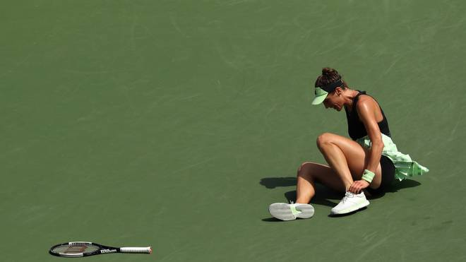 NEW YORK, NEW YORK - AUGUST 31:  Andrea Petkovic of Germany falls during her Women's Singles third round match against Elise Mertens of Belgium on day six of the 2019 US Open at the USTA Billie Jean King National Tennis Center on August 31, 2019 in Queens borough of New York City. (Photo by Matthew Stockman/Getty Images)