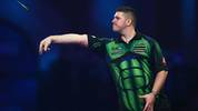 LONDON, ENGLAND - DECEMBER 27: Daryl Gurney of Northern Ireland throws during his third round match against Glen Durrant of England on Day 12 of the 2020 William Hill World Darts Championship at Alexandra Palace on December 27, 2019 in London, England. (Photo by Jordan Mansfield/Getty Images)