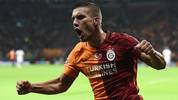 Galatasaray's German forward Lukas Podolski celebrates scoring during the UEFA Champions League football match between Galatasaray AS and SL Benfica at the Ali Sami Yen Spor Kompleks stadium in Istanbul on October 21, 2015. AFP PHOTO / OZAN KOSE        (Photo credit should read OZAN KOSE/AFP via Getty Images)
