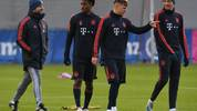 (L-R) Bayern Munich's coach Hansi Flick, Bayern Munich's French defender Kingsley Coman, Bayern Munich's midfielder Joshua Kimmich and Bayern Munich's striker Thomas Mueller attend a training session on the eve of the UEFA Champions League Group B football match between FC Bayern Munich and Tottenham Hotspur at the clubs training ground in Munich, southern Germany, on December 10, 2019. (Photo by Christof STACHE / AFP) (Photo by CHRISTOF STACHE/AFP via Getty Images)