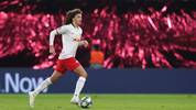 Leipzig's Welsh defender Ethan Ampadu runs with the ball during the UEFA Champions League Group G football match between RB Leipzig and SL Benfica on November 27, 2019, in Leipzig, eastern Germany. (Photo by Ronny Hartmann / AFP) (Photo by RONNY HARTMANN/AFP via Getty Images)