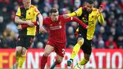LIVERPOOL, ENGLAND - DECEMBER 14:  Xherdan Shaqiri of Liverpool is tackled by Will Hughes (L) and Etienne Capoue of Watford during the Premier League match between Liverpool FC and Watford FC at Anfield on December 14, 2019 in Liverpool, United Kingdom. (Photo by Clive Brunskill/Getty Images)