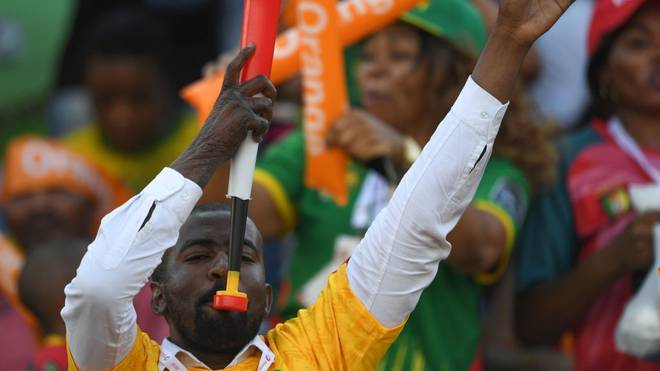 Cameroon fans cheer ahead of the 2019 Africa Cup of Nations (CAN) football match between Cameroon and Guinea-Bissau at the Ismailia Stadium on June 25, 2019. (Photo by OZAN KOSE / AFP)        (Photo credit should read OZAN KOSE/AFP via Getty Images)