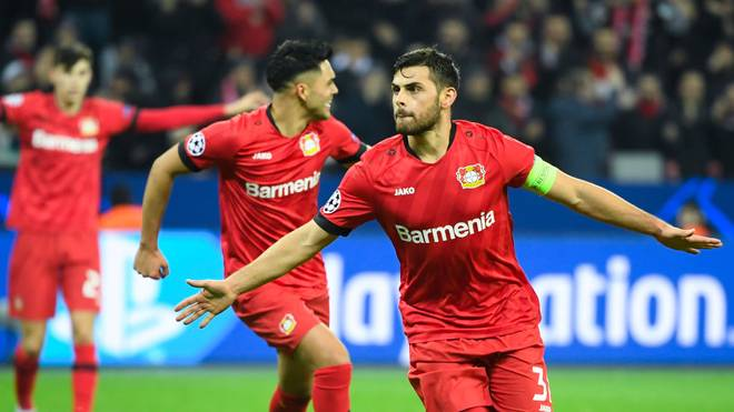 Leverkusen's German forward Kevin Volland celebrates scoring the 2-0 goal with his team-mates during the UEFA Champions League Group D football match Bayer Leverkusen v Atletico Madrid in Leverkusen, western Germany on November 6, 2019. (Photo by INA FASSBENDER / AFP) (Photo by INA FASSBENDER/AFP via Getty Images)