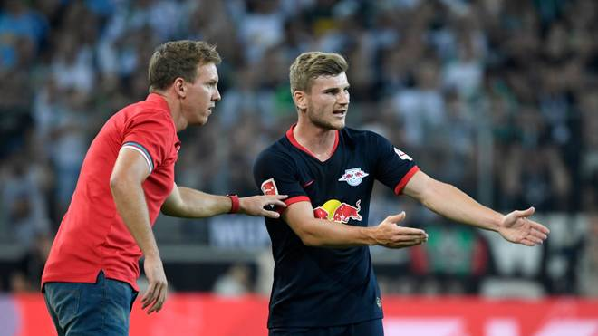 Leipzig's German headcoach Julian Nagelsmann and Leipzig's German forward Timo Werner (R) talk during the German first division Bundesliga football match Borussia Moenchengladbach v RB Leipzig in Moenchengladbach, western Germany on August 30, 2019. (Photo by Ina FASSBENDER / AFP) / RESTRICTIONS: DFL REGULATIONS PROHIBIT ANY USE OF PHOTOGRAPHS AS IMAGE SEQUENCES AND/OR QUASI-VIDEO        (Photo credit should read INA FASSBENDER/AFP via Getty Images)