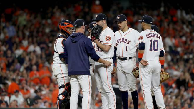 HOUSTON, TEXAS - OCTOBER 23:  Justin Verlander #35 of the Houston Astros is taken out of the game by manager AJ Hinch #14 against the Washington Nationals during the seventh inning in Game Two of the 2019 World Series at Minute Maid Park on October 23, 2019 in Houston, Texas. (Photo by Elsa/Getty Images)