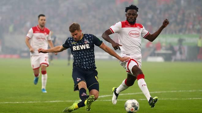 Für Terodde(l.) und den 1. FC Köln lauft es in dieser Saison noch nicht
