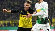 Dortmund's Polish defender Lukasz Piszczek (L) and Moenchengladbach's Algerian defender Ramy Bensebaini vie for the ball during the German Cup (DFB Pokal) second round football match BVB Borussia Dortmund v Borussia Moenchenglanbach in Dortmund, western Germany on October 30, 2019. (Photo by INA FASSBENDER / AFP) / DFB REGULATIONS PROHIBIT ANY USE OF PHOTOGRAPHS AS IMAGE SEQUENCES AND QUASI-VIDEO. (Photo by INA FASSBENDER/AFP via Getty Images)