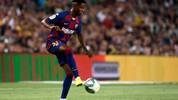 Barcelona´s Guinea-Bissau forward Ansu Fati controls the ball during the Spanish League football match between Barcelona and Real Betis at the Camp Nou stadium in Barcelona on August 25, 2019. (Photo by Josep LAGO / AFP)        (Photo credit should read JOSEP LAGO/AFP/Getty Images)