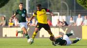 DORTMUND, GERMANY - JUNE 05: Youssoufa Moukoko of Dortmund (L) tackles Nikolas Hofmann of Wolfsburg during the under 17 juniors match between Borussia Dortmund and VFL Wolfsburg  on June 05, 2019 in Dortmund, Germany. (Photo by Juergen Schwarz/Getty Images)