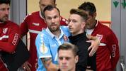 Uerdingen's Kevin Grosskreutz (L) and Dortmund's Dortmund's German midfielder Marco Reus hug prior to the German Cup (DFB Pokal) first round match between KFC Uerdingen 05 and BVB Borussia Dortmund in Duesseldorf, western Germany on August 9, 2019. (Photo by INA FASSBENDER / AFP) / DFB REGULATIONS PROHIBIT ANY USE OF PHOTOGRAPHS AS IMAGE SEQUENCES AND QUASI-VIDEO.        (Photo credit should read INA FASSBENDER/AFP via Getty Images)