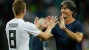 Germany's midfielder Toni Kroos (L) is congratulated by Germany's coach Joachim Loew (R) at the end of the Russia 2018 World Cup Group F football match between Germany and Sweden at the Fisht Stadium in Sochi on June 23, 2018. (Photo by Odd ANDERSEN / AFP) / RESTRICTED TO EDITORIAL USE - NO MOBILE PUSH ALERTS/DOWNLOADS        (Photo credit should read ODD ANDERSEN/AFP via Getty Images)