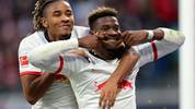 LEIPZIG, GERMANY - NOVEMBER 02: Nordi Mukiele of RB Leipzig celebrates  scoring his team's seventh goal with Christopher Nkunku  during the Bundesliga match between RB Leipzig and 1. FSV Mainz 05 at Red Bull Arena on November 02, 2019 in Leipzig, Germany. (Photo by Boris Streubel/Bongarts/Getty Images)