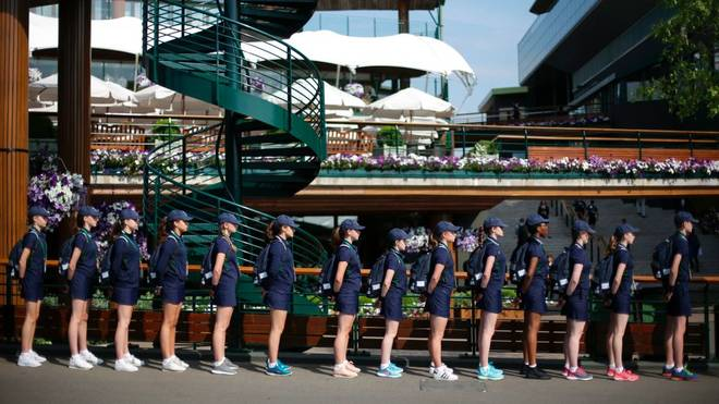 Ball-kids queue up ahead of play at The All England Lawn Tennis Club in Wimbledon, southwest London, on July 6, 2017 on the fourth day of the 2017 Wimbledon Championships. / AFP PHOTO / DANIEL LEAL-OLIVAS / RESTRICTED TO EDITORIAL USE        (Photo credit should read DANIEL LEAL-OLIVAS/AFP/Getty Images)