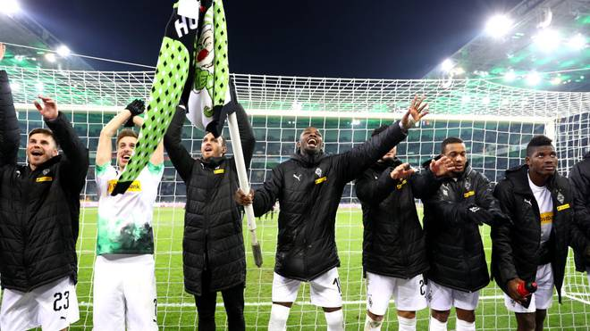 MOENCHENGLADBACH, GERMANY - DECEMBER 01: Marcus Thuram of Borussia Monchengladbach holds a corner flag as hecelebrates with his team mates during the Bundesliga match between Borussia Moenchengladbach and Sport-Club Freiburg at Borussia-Park on December 01, 2019 in Moenchengladbach, Germany. (Photo by Lars Baron/Bongarts/Getty Images)