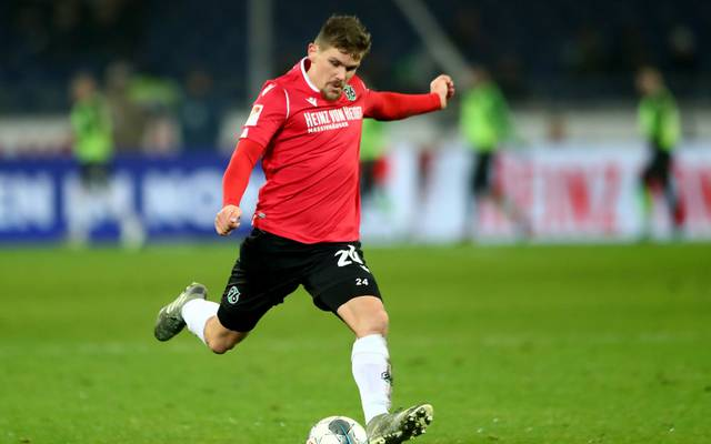 HANOVER, GERMANY - NOVEMBER 25: Sebastian Jung of Hannover runs with the ball during the Second Bundesliga match between Hannover 96 and SV Darmstadt 98 at HDI-Arena on November 25, 2019 in Hanover, Germany. (Photo by Martin Rose/Bongarts/Getty Images)