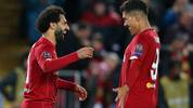 LIVERPOOL, ENGLAND - OCTOBER 02: Mohamed Salah of Liverpool celebrates with Roberto Firmino after he scores his sides fourth goal during the UEFA Champions League group E match between Liverpool FC and RB Salzburg at Anfield on October 02, 2019 in Liverpool, United Kingdom. (Photo by Alex Livesey/Getty Images)