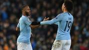 Manchester City's English striker Raheem Sterling (L) celebrates with Manchester City's German midfielder Leroy Sane after scoring their fourth goal during the UEFA Champions League round of 16 second leg football match between Manchester City and Schalke 04 at the Etihad Stadium in Manchester, north west England, on March 12, 2019. (Photo by Oli SCARFF / AFP)        (Photo credit should read OLI SCARFF/AFP via Getty Images)