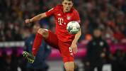 MUNICH, GERMANY - JANUARY 25: Benjamin Pavard of Bayern Muenchen battles for the ball during the Bundesliga match between FC Bayern Muenchen and FC Schalke 04 at Allianz Arena on January 25, 2020 in Munich, Germany. (Photo by Alexander Hassenstein/Bongarts/Getty Images)