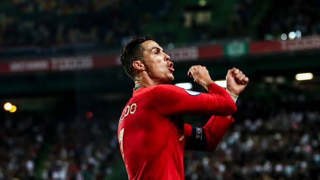 Portugal's forward Cristiano Ronaldo celebrates after scoring a goal during the Euro 2020 qualifier group B football match between Portugal and Luxembourg at the Jose Alvalade stadium in Lisbon on October 11, 2019. (Photo by CARLOS COSTA / AFP) (Photo by CARLOS COSTA/AFP via Getty Images)
