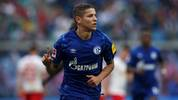 Schalke's French midfielder Amine Harit celebrates scoring the 2-0 during the German First division Bundesliga football match between RB Leipzig and Schalke 04 in Leipzig, on September 28, 2019. (Photo by Ronny Hartmann / AFP) / DFL REGULATIONS PROHIBIT ANY USE OF PHOTOGRAPHS AS IMAGE SEQUENCES AND/OR QUASI-VIDEO        (Photo credit should read RONNY HARTMANN/AFP/Getty Images)