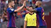 Barcelona's Chilean midfielder Arturo Vidal (R) replaces Barcelona's Croatian midfielder Ivan Rakitic during the Spanish league football match between FC Barcelona and SD Huesca at the Camp Nou stadium in Barcelona on September 2, 2018. (Photo by LLUIS GENE / AFP)        (Photo credit should read LLUIS GENE/AFP/Getty Images)