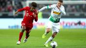 MOENCHENGLADBACH, GERMANY - DECEMBER 07: Kingsley Coman of FC Bayern Munich is challenged by Nico Elvedi of Borussia Monchengladbach during the Bundesliga match between Borussia Moenchengladbach and FC Bayern Muenchen at Borussia-Park on December 07, 2019 in Moenchengladbach, Germany. (Photo by Lars Baron/Bongarts/Getty Images)