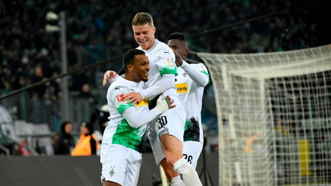 Moenchengladbach's Swiss forward Breel Embolo, French forward Alassane Plea and Moenchengladbach's Swiss defender Nico Elvedi celebrate a goal during during the German first division Bundesliga football match Borussia Moenchengladbach v Mainz 05 in Moenchengladbach on January 25, 2020. (Photo by INA FASSBENDER / AFP) / DFL REGULATIONS PROHIBIT ANY USE OF PHOTOGRAPHS AS IMAGE SEQUENCES AND/OR QUASI-VIDEO (Photo by INA FASSBENDER/AFP via Getty Images)