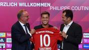 Bayern Munich's CEO Karl-Heinz Rummenigge (L), Bayern Munich's Croatian sports director Hasan Salihamidzic (R) and Brazilian midfielder Philippe Coutinho, the new recruit of German first division Bundesliga football club FC Bayern Munich, pose with his jersey during his presentation in the stadium in Munich, southern Germany, on August 19, 2019. - Coutinho has joined Bayern Munich on a one-year loan worth 8.5 million euros ($9.5 million) with an option to buy, Spanish club Barcelona confirmed on August 19, 2019. (Photo by Christof STACHE / AFP)        (Photo credit should read CHRISTOF STACHE/AFP via Getty Images)