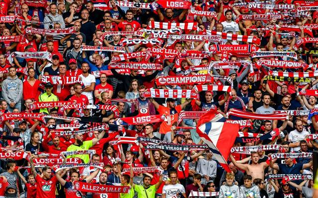 Lille's supporters cheer their team during the French L1 football match between Lille (LOSC) and FC Nantes at the Pierre-Mauroy stadium in Villeneuve-d'Ascq northern France, on August 11, 2019. (Photo by PHILIPPE HUGUEN / AFP)        (Photo credit should read PHILIPPE HUGUEN/AFP/Getty Images)