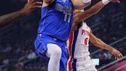 DETROIT, MICHIGAN - OCTOBER 09: Luka Doncic #77 of the Dallas Mavericks takes a first half shot in front of Bruce Brown #6 of the Detroit Pistons at Little Caesars Arena on October 09, 2019 in Detroit, Michigan.  NOTE TO USER: User expressly acknowledges and agrees that, by downloading and/or using this photograph, user is consenting to the terms and conditions of the Getty Images License Agreement. (Photo by Gregory Shamus/Getty Images)