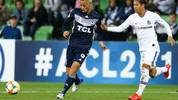 Melbourne Victorys Keisuke Honda (L) passes the ball during the AFC Champions League football match between Australias Melbourne Victory and Japans Sanfrecce Hiroshima in Melbourne on May 22, 2019. (Photo by ASANKA BRENDON RATNAYAKE / AFP) / -- IMAGE RESTRICTED TO EDITORIAL USE - STRICTLY NO COMMERCIAL USE --        (Photo credit should read ASANKA BRENDON RATNAYAKE/AFP/Getty Images)