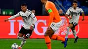 Germany's midfielder Serge Gnabry (L) runs with the ball during the UEFA Nations League football match Germany v the Netherlands in Gelsenkirchen, western Germany, on November 19, 2018. (Photo by John MACDOUGALL / AFP)        (Photo credit should read JOHN MACDOUGALL/AFP/Getty Images)