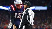 FOXBOROUGH, MASSACHUSETTS - DECEMBER 08: Tom Brady #12 of the New England Patriots argues a call with head linesman Wayne  Mackie during the fourth quarter of the game between the New England Patriots and the Kansas City Chiefs at Gillette Stadium on December 08, 2019 in Foxborough, Massachusetts. (Photo by Adam Glanzman/Getty Images)