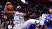 DETROIT, MICHIGAN - NOVEMBER 25: Andre Drummond #0 of the Detroit Pistons tries to control the ball next to Jonathan Isaac #1 of the Orlando Magic during the second half at Little Caesars Arena on November 25, 2019 in Detroit, Michigan. Detroit won the game 103-88. NOTE TO USER: User expressly acknowledges and agrees that, by downloading and or using this photograph, User is consenting to the terms and conditions of the Getty Images License Agreement.  (Photo by Gregory Shamus/Getty Images)