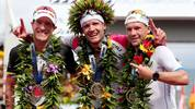 KAILUA KONA, HI - OCTOBER 08:  (L-R) Sebastian Kienle #2 of Germany, in second place, Jan Frodeno #1 of Germany, in first place, and Patrick Lange #20 of Germany, in third place, celebrates after finishing the 2016 IRONMAN World Championship triathlon on October 8, 2016 in Kailua Kona, Hawaii.  (Photo by Tom Pennington/Getty Images for Ironman)