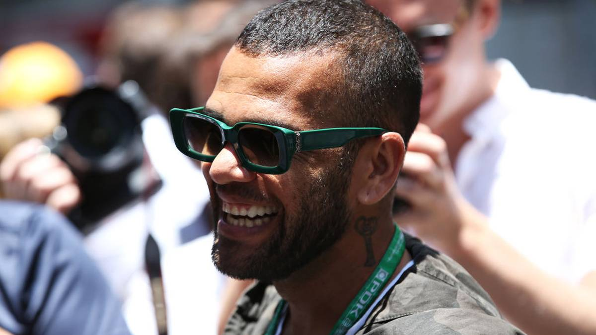 SAO PAULO, BRAZIL - NOVEMBER 17: Footballer Dani Alves looks on in the Paddock before the F1 Grand Prix of Brazil at Autodromo Jose Carlos Pace on November 17, 2019 in Sao Paulo, Brazil. (Photo by Charles Coates/Getty Images)