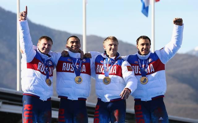 Alexej Wojewoda (r.) gewann 2014 mit dem russischen Viererbob Olympiagold