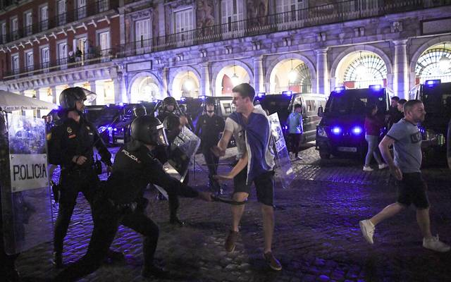 Police clash with Leicester City fans in Madrid