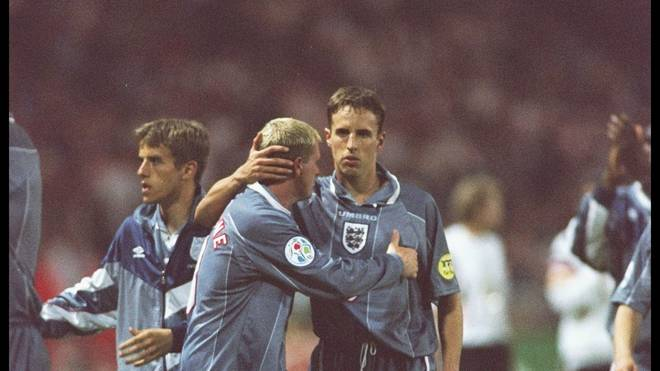 Paul Gascoigne and teammate Gareth Southgate of England show the agony of defeat