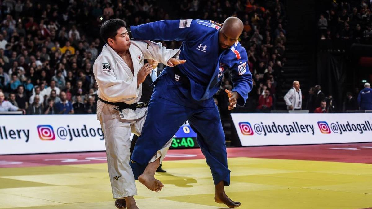 France's Teddy Riner (R) fights against Japan's Kokoro Kageura during the over 100 kg category men's third round fight at the Judo Paris Grand Slam 2020, in Paris, France. (Photo by Lucas Barioulet / AFP) (Photo by LUCAS BARIOULET/AFP via Getty Images)
