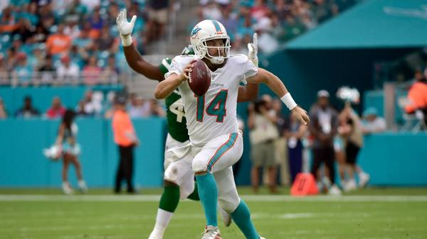 MIAMI, FL - NOVEMBER 03: Ryan Fitzpatrick #14 of the Miami Dolphins scrambles out of the pocket during the second quarter against the New York Jets at Hard Rock Stadium on November 3, 2019 in Miami, Florida. (Photo by Eric Espada/Getty Images)